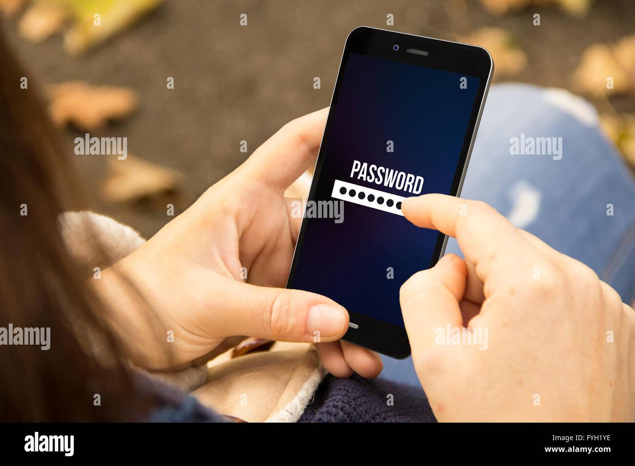 mobile Security-Konzept: junge Frau, die Passworteingabe auf einem 3d generierte Telefon im Park Stockbild