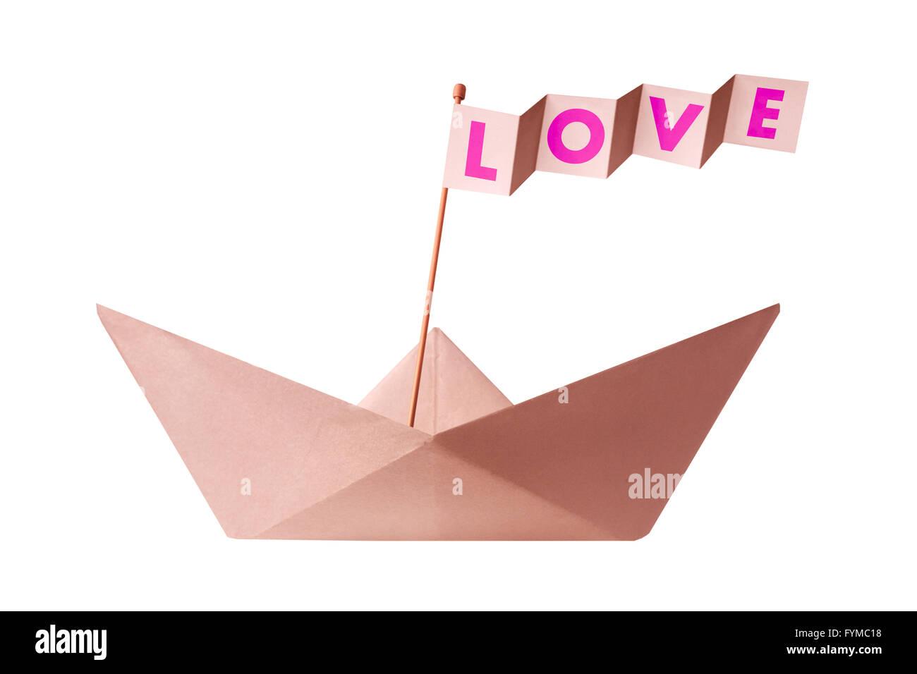 Origami Papierboot mit Flagge, die Liebe zu schreiben Stockbild