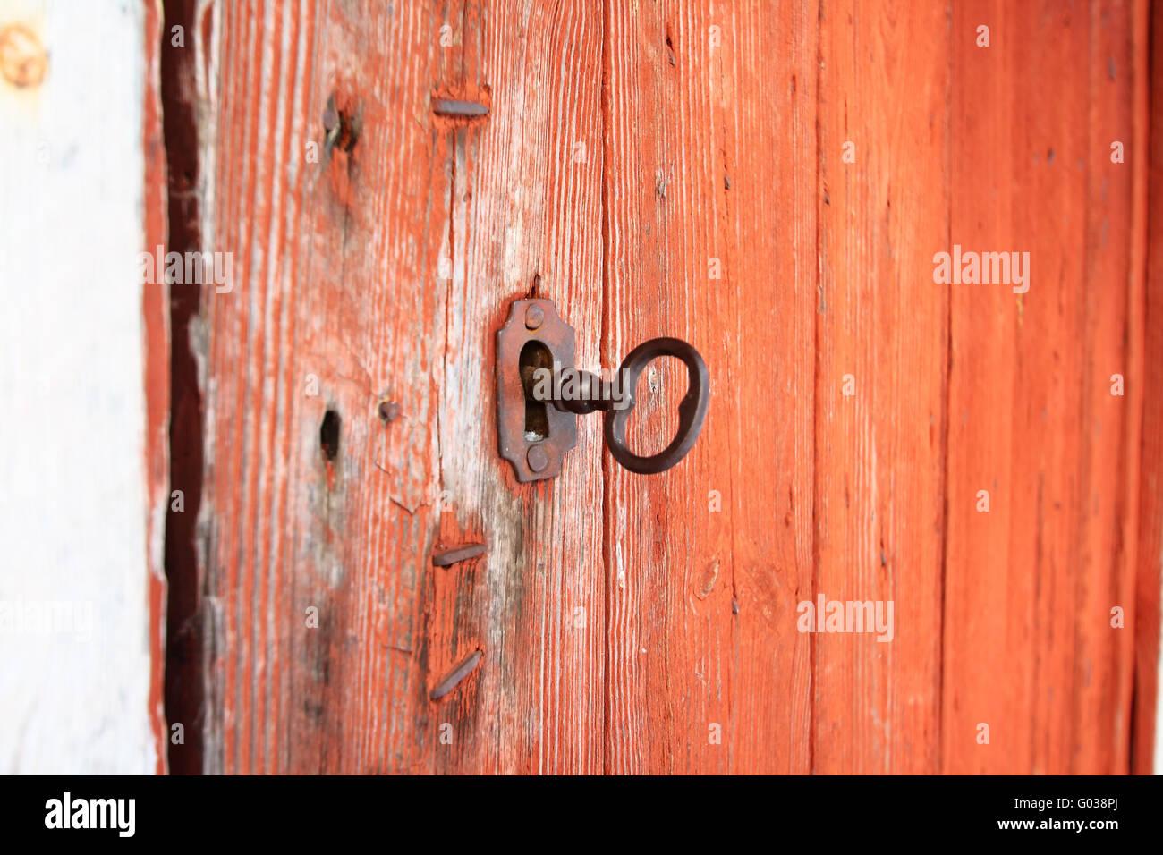 Schlüssel in das Schloss Stockbild