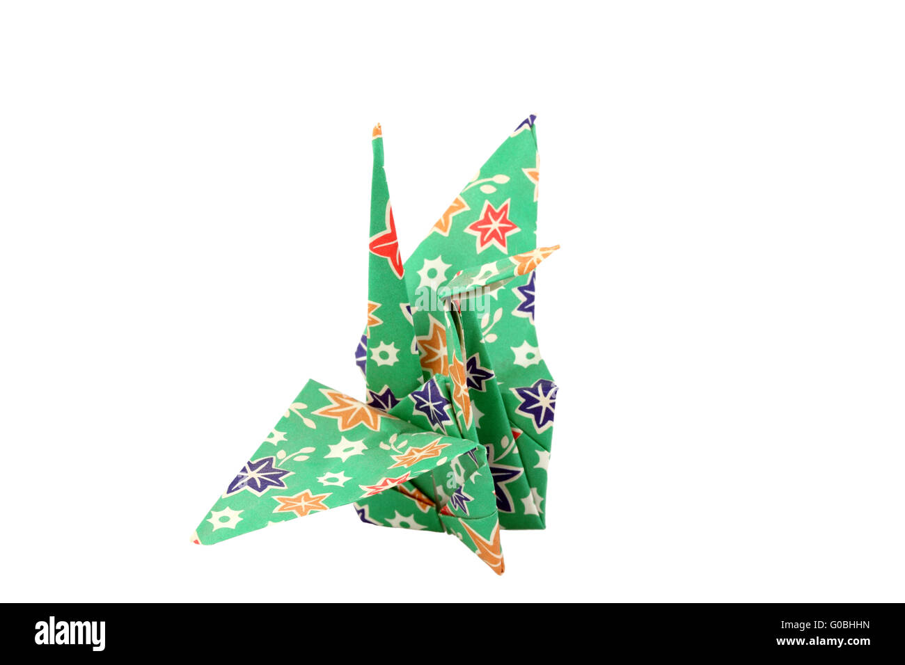 Nahaufnahme des Origami Papier Kran grün mit bunten Mustern Stockbild