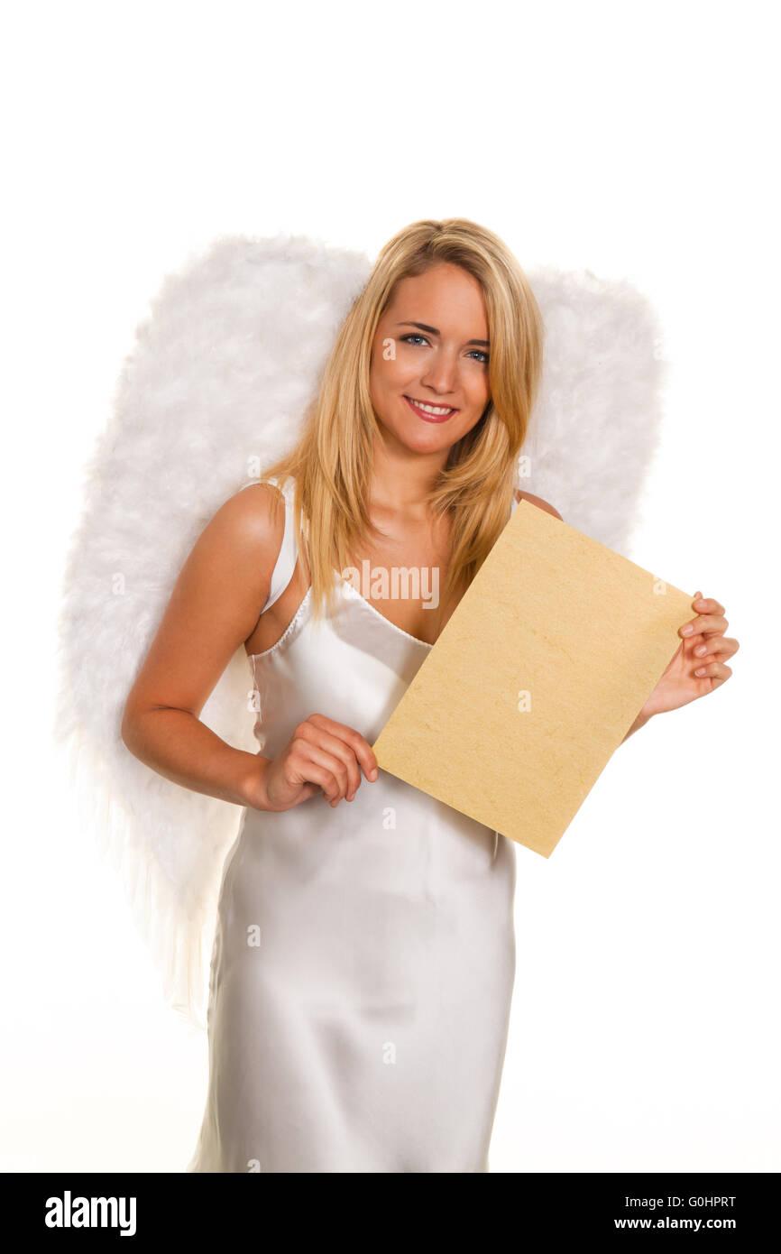 Engel für Weihnachten mit einem leeren Anfrage schreiben. Stockfoto