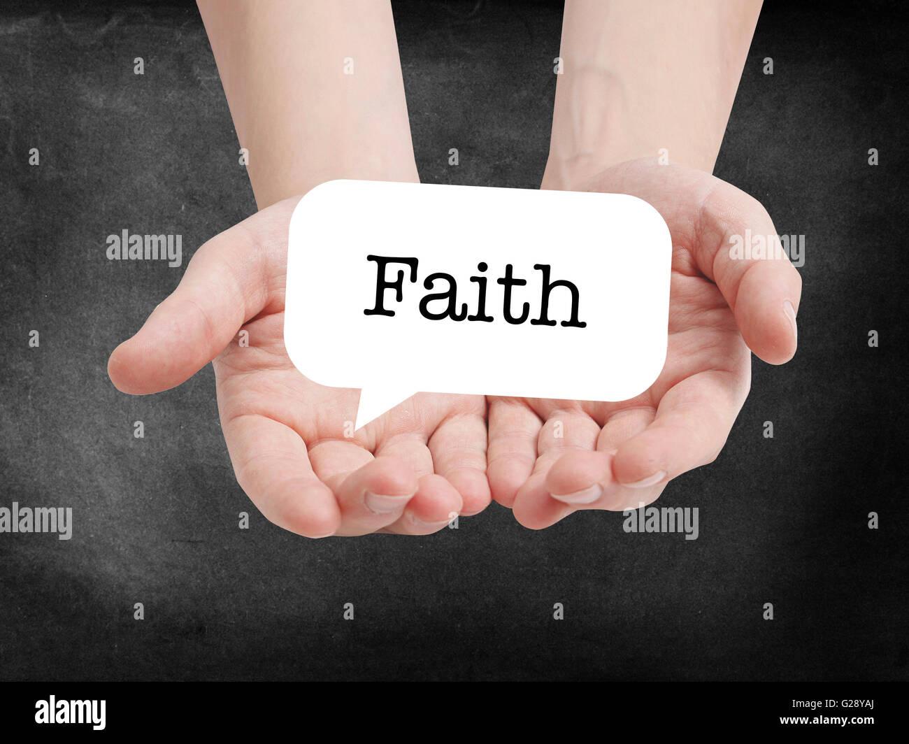Glaubens auf eine Speechbubble geschrieben Stockbild
