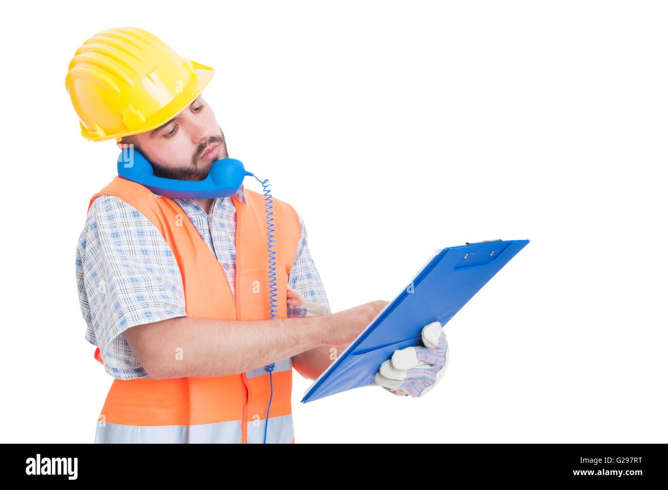 Beschäftigt-Generator mit Telefon mit gedrückter Zwischenablage. Unterstützung oder Hilfe für Bauunternehmen Stockfoto