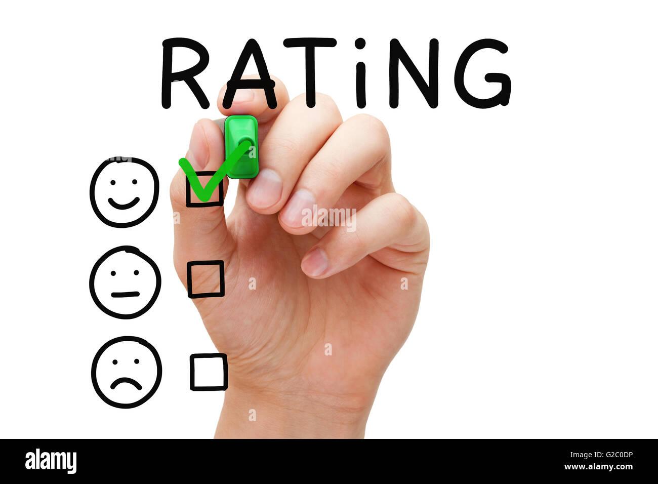 Hand, Häkchen mit grüne Markierung auf hervorragende Bewertung. Kunden-Zufriedenheit-Konzept. Stockbild
