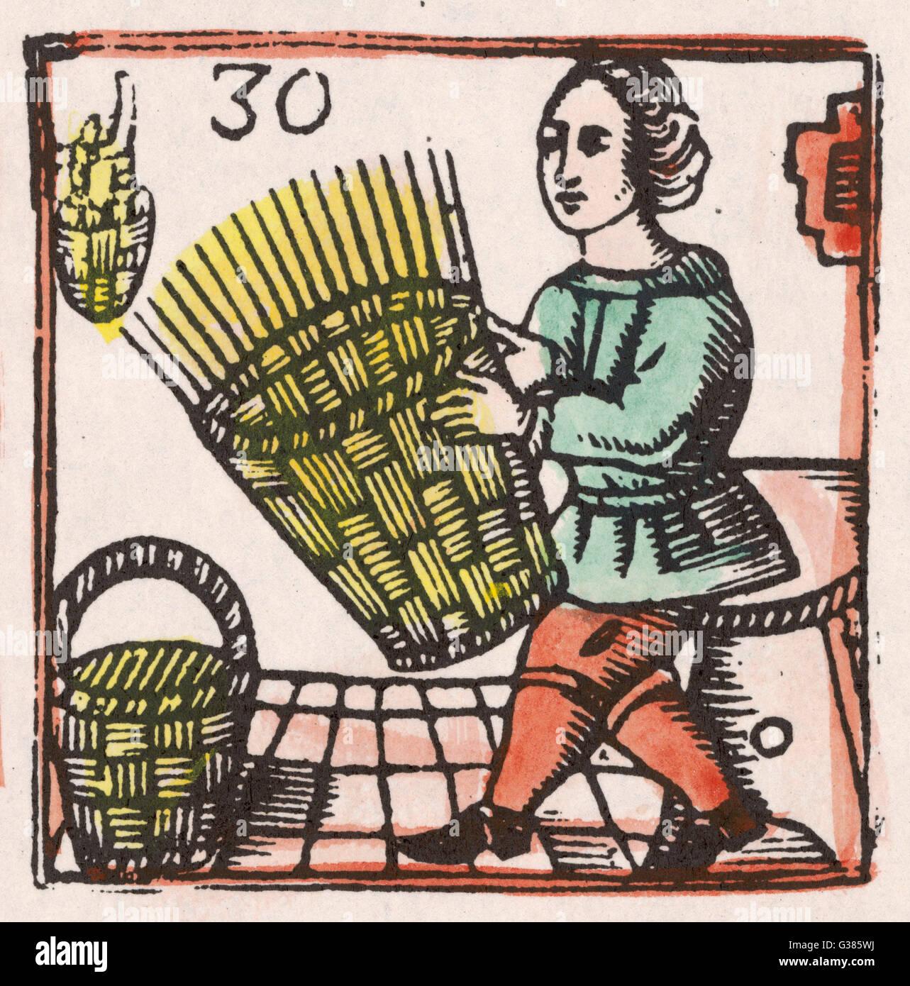 Ein Korbmacher bei der Arbeit auf einem fast fertigen Korb.         Datum: 17. Jahrhundert Stockbild