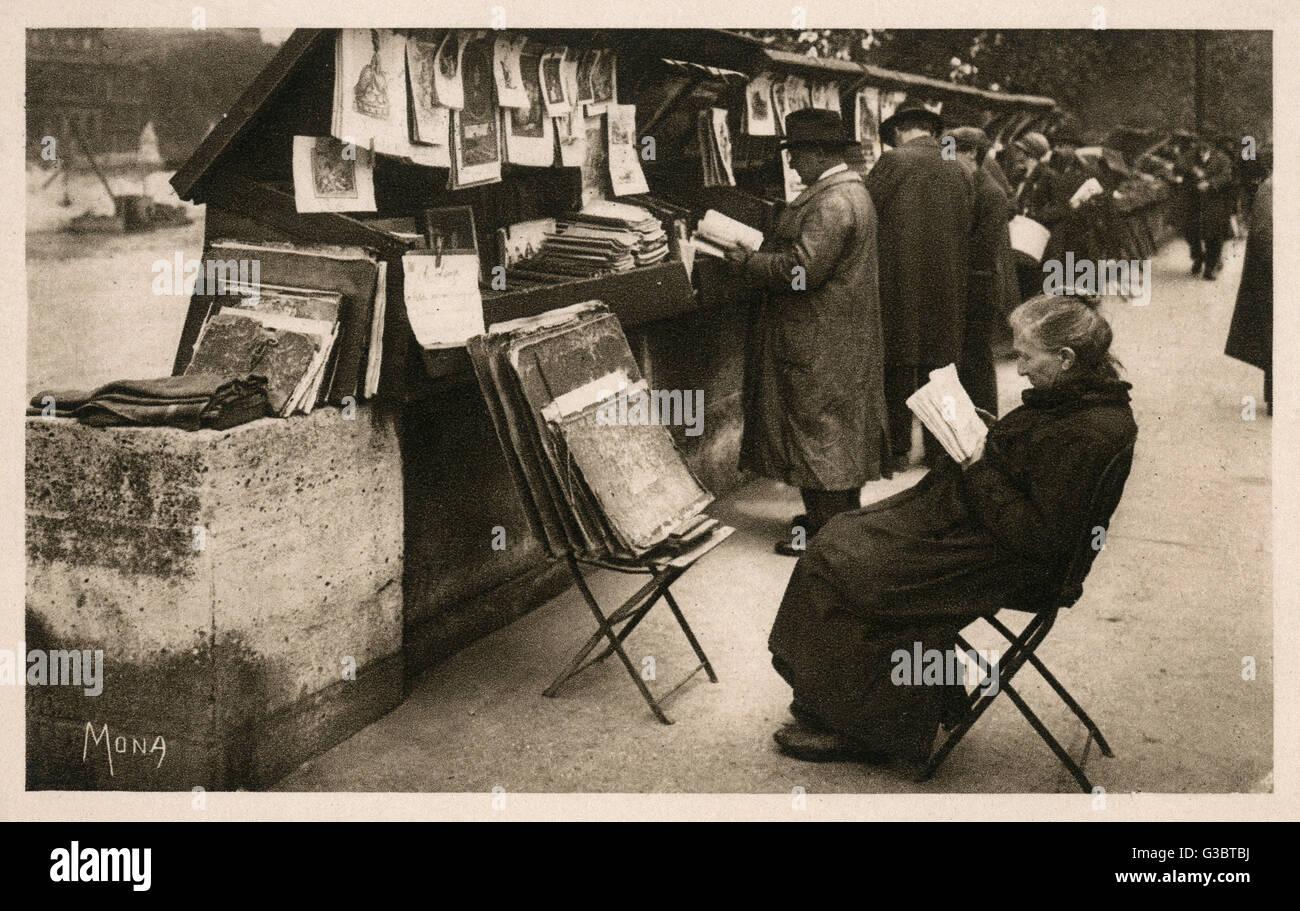 Blick durch lose Drucke auf der Paris-Quais am Ufer der Seine.     Datum: 1929 Stockbild