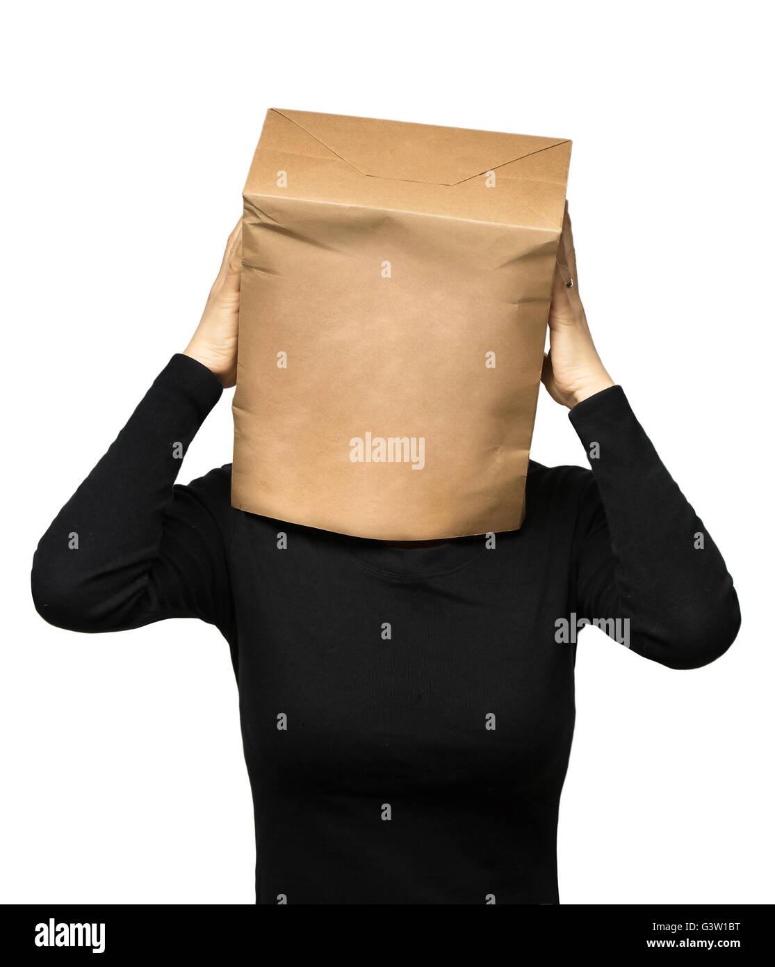 junge Frau, die seinen Kopf mit einer Papiertüte zu bedecken. Frau Sorge Stockbild