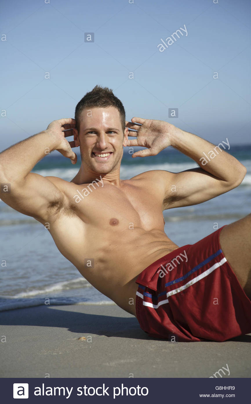 Mann Sit am Strand Stockbild