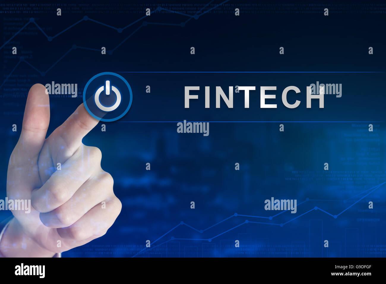 Doppelbelichtung Business Hand anklicken Fintech oder Finanztechnologie Knopf mit unscharfen Hintergrund Stockbild