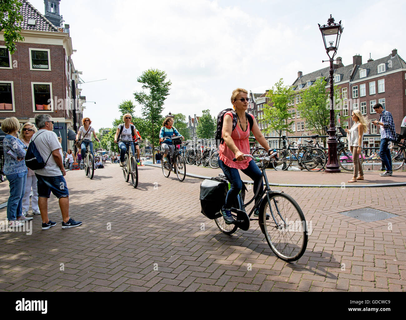 cycling amsterdam stockfotos cycling amsterdam bilder. Black Bedroom Furniture Sets. Home Design Ideas