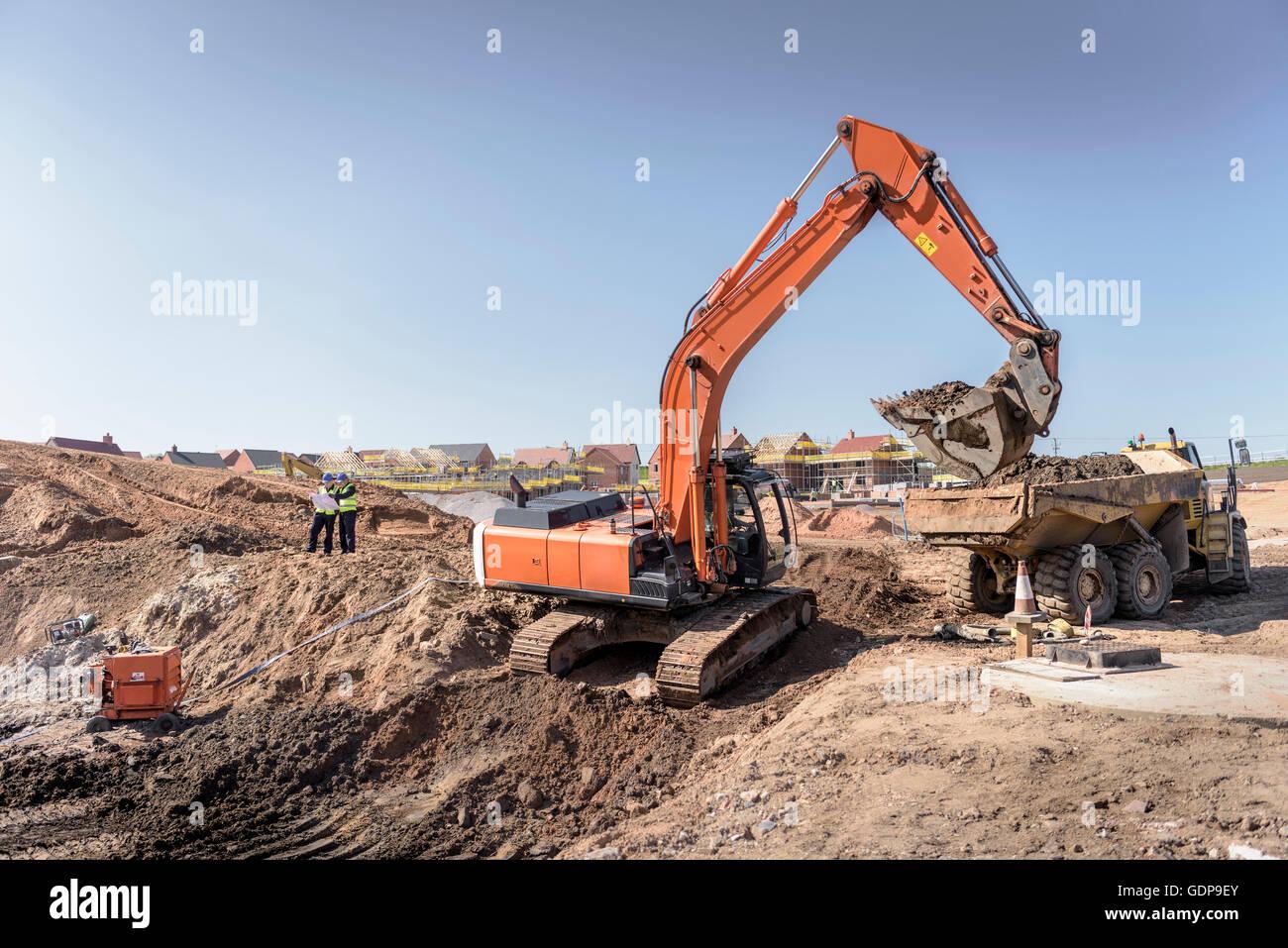 Bagger Gehäuse Baustelle Erde weiter Stockfoto