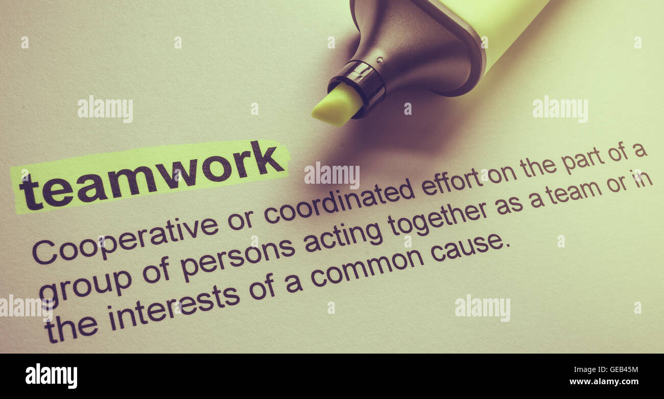 Definition der Teamarbeit, in Farbe hervorgehoben. Stockfoto