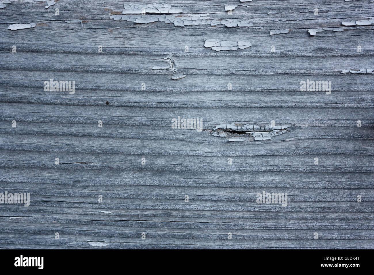 Graue Holzbrett mit abgeplatzte Farbe strukturierten Hintergrund Stockfoto