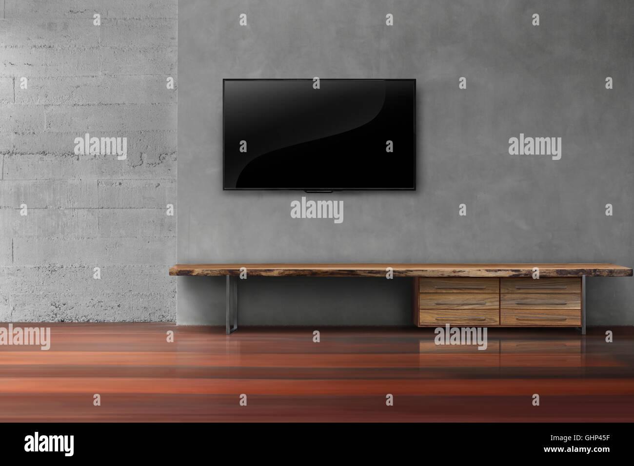 led tv auf betonwand mit holzm beln im leeren wohnzimmer. Black Bedroom Furniture Sets. Home Design Ideas