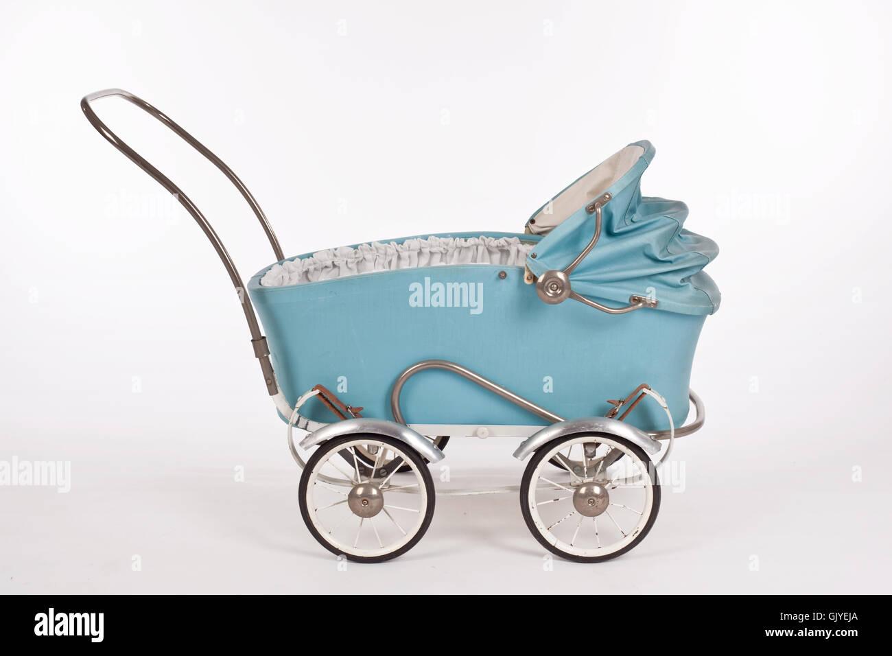 alten leichten blauen puppenwagen Stockbild