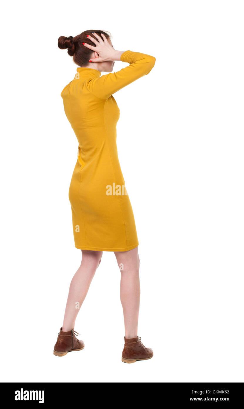 15f4727f00c0db Rückansicht des schockiert Frau im Kleid. junges Mädchen aufregen. Hintere  Ansicht Menschen Sammlung. Rückseite Blick auf Person. Über isoliert