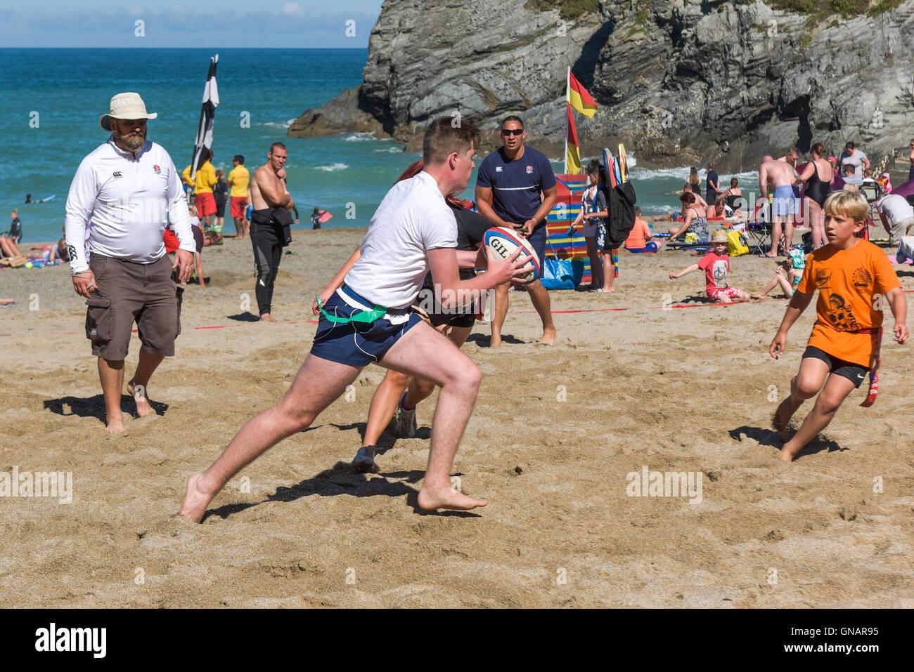 Die jährliche Lusty Glasur Strand Tag Rugby-Turnier in Newquay, Cornwall. Stockbild