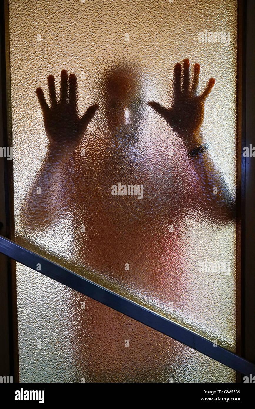 Mann an der Tür Stockbild