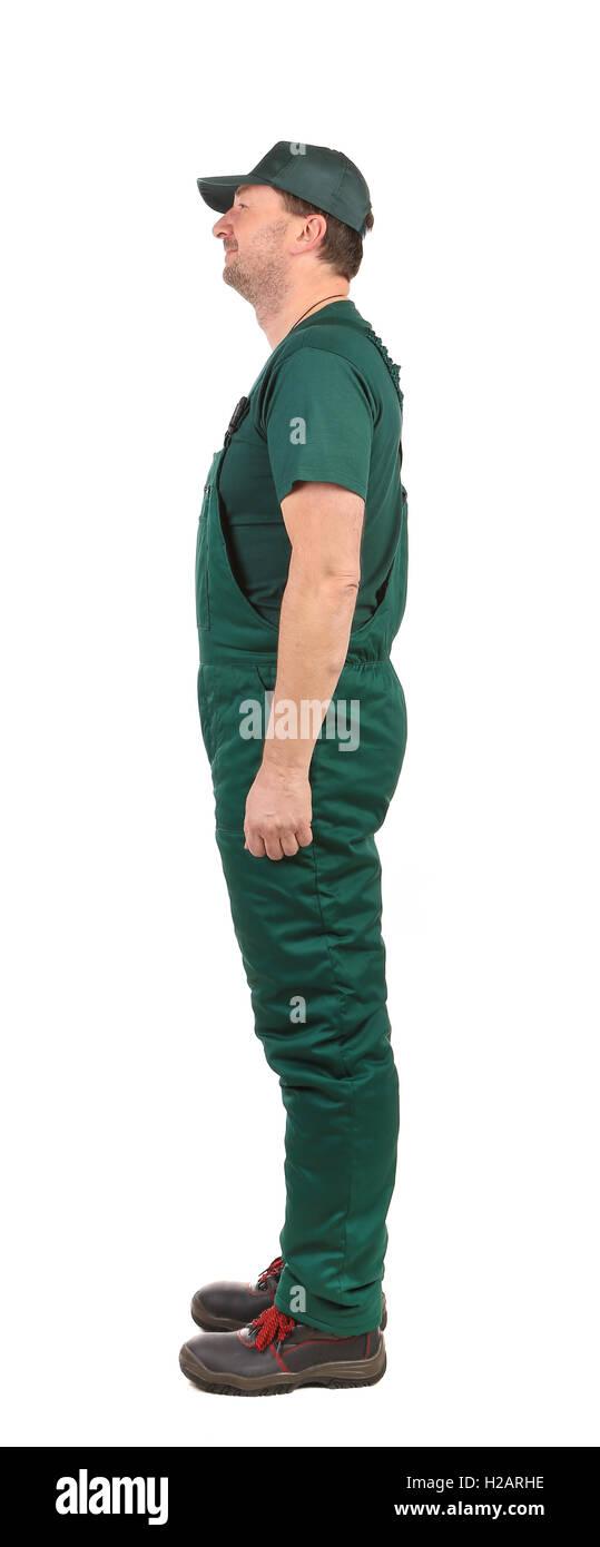 Profil Mann in grünen overalls Stockbild