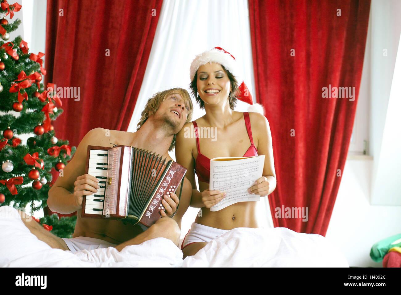 Weihnachten, Bett, paar, glücklich, Weihnachtslieder, singt ...