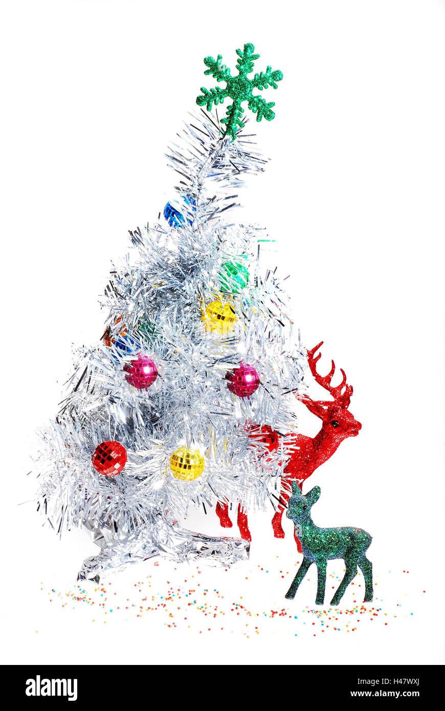 Kitschige Weihnachtsdeko weihnahtbaum verziert dekoration hirsch kitz figuren in eine
