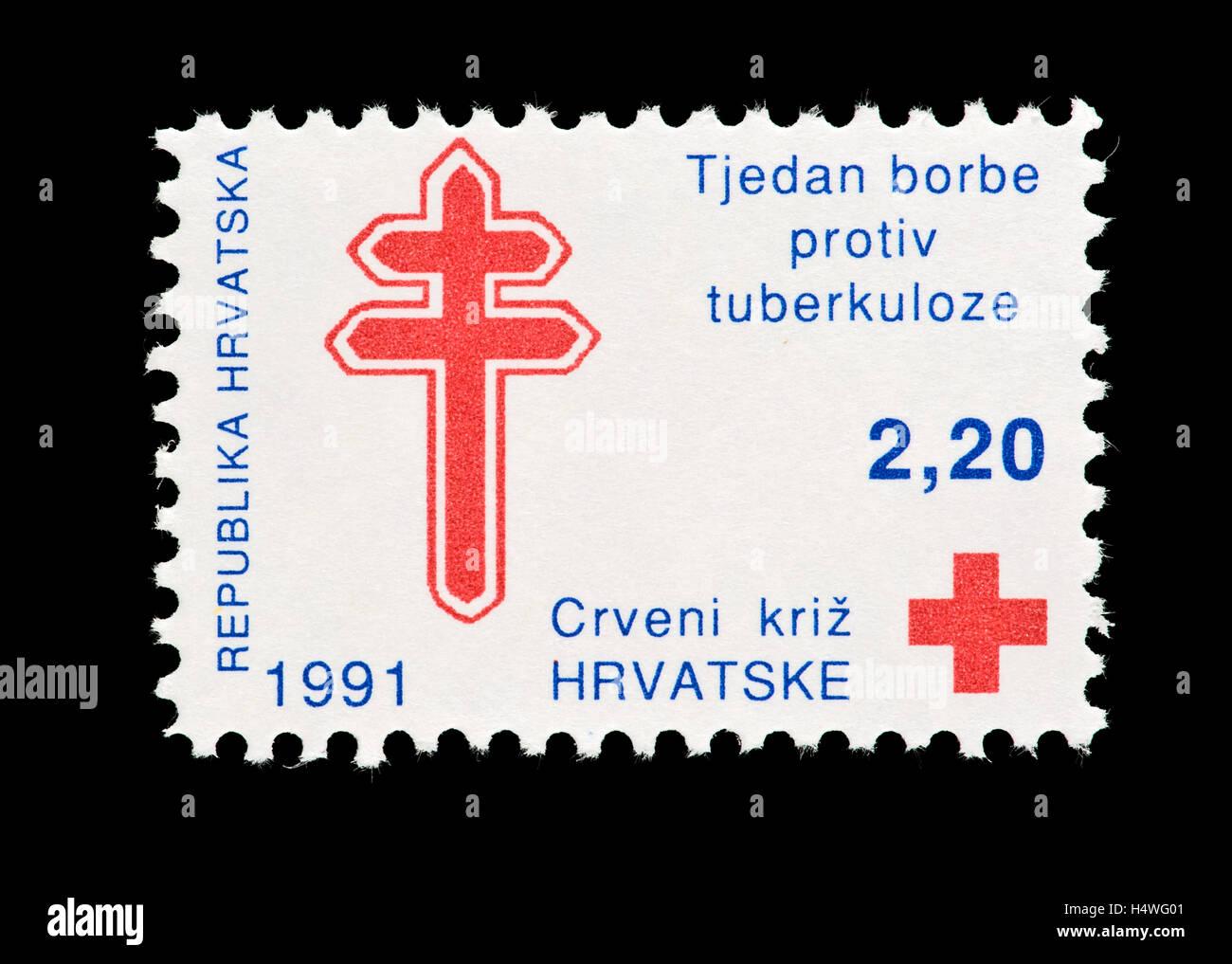 Briefmarke aus Kroatien mit einem roten Kreuz und das Symbol für ...