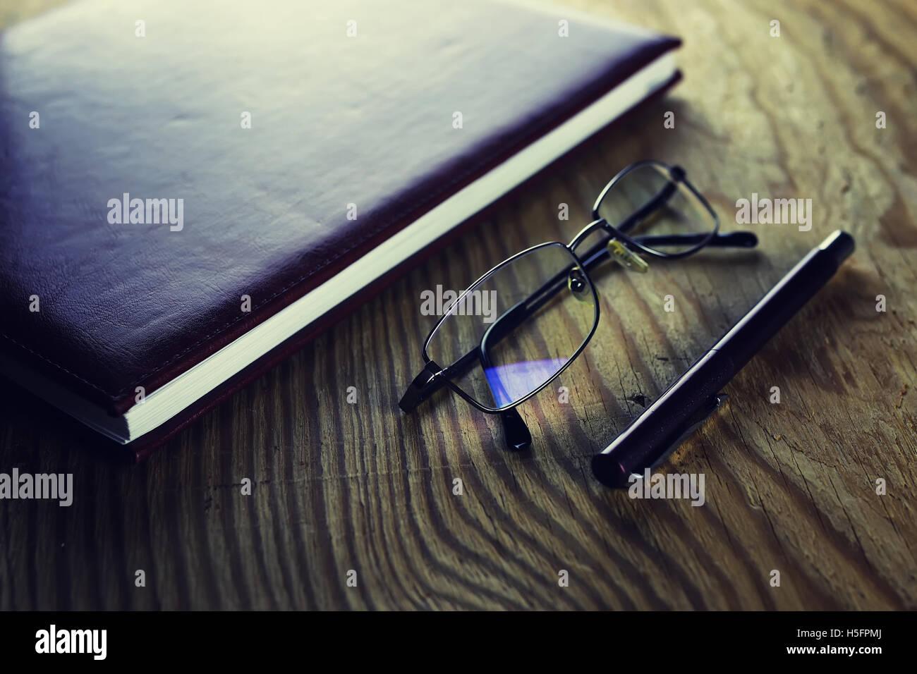 Business-Stift-Gläser-notebook Stockfoto
