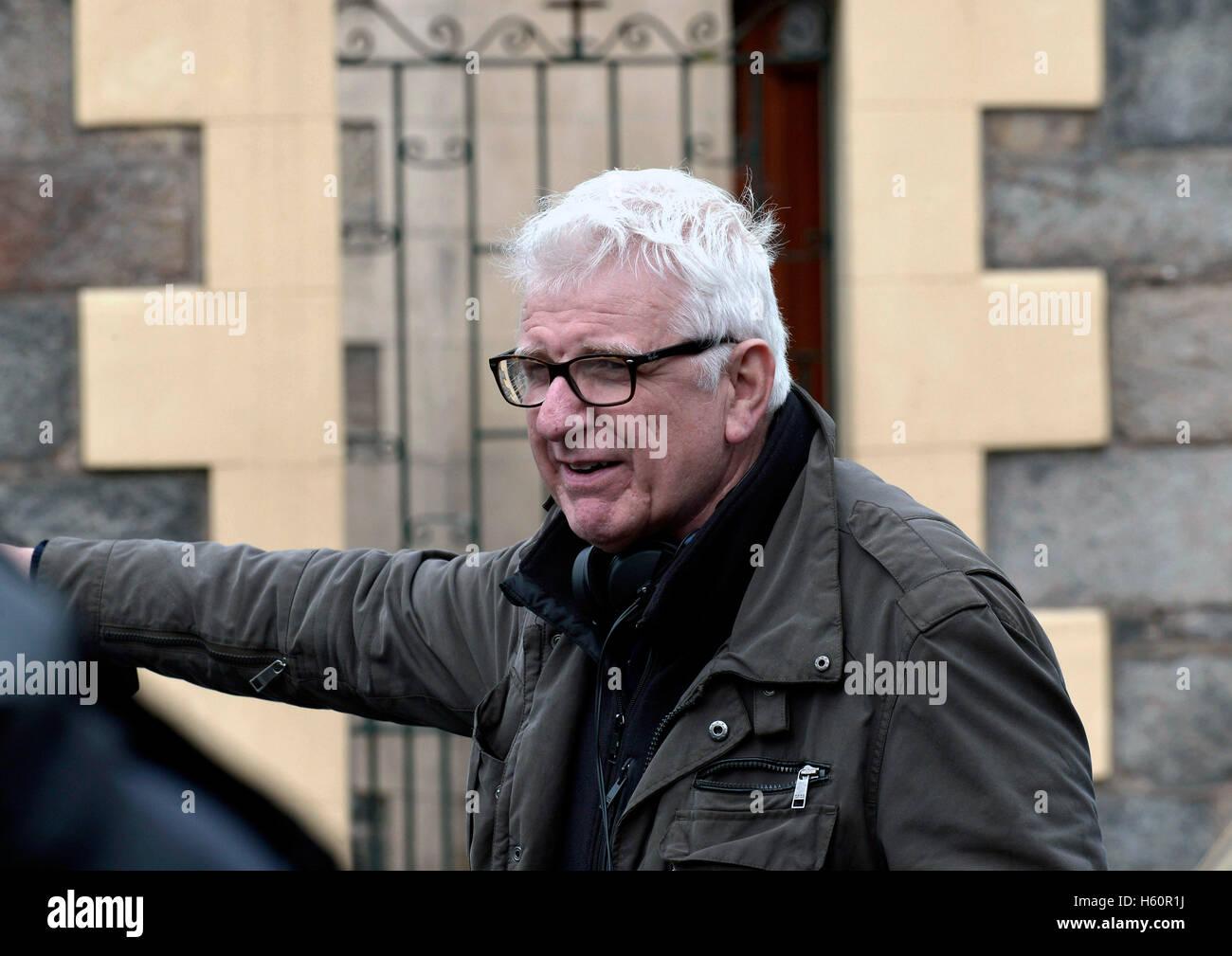Irischer Filmregisseur und Produzent Tom Collins auf dem Filmset der Buße in Londonderry. Stockbild