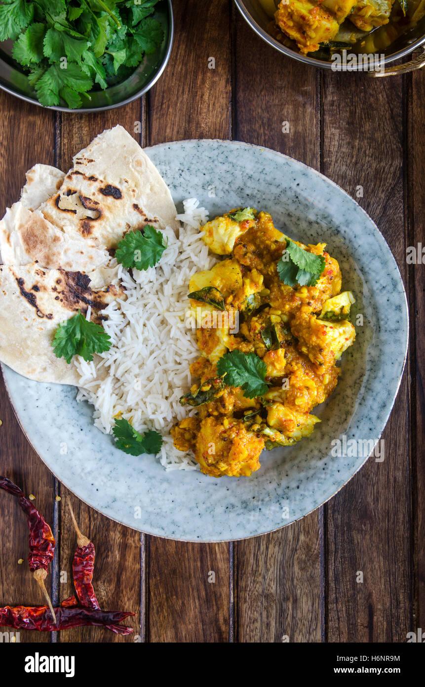 Indische Kabeljau-Curry mit Basmati-Reis Stockbild