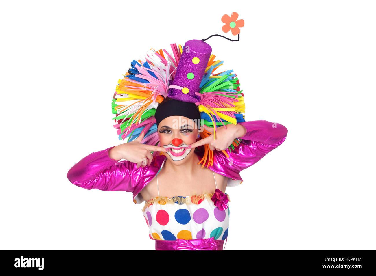 Lustiges Mädchen Clown mit einem schönen Lächeln isoliert auf weißem Hintergrund Stockfoto