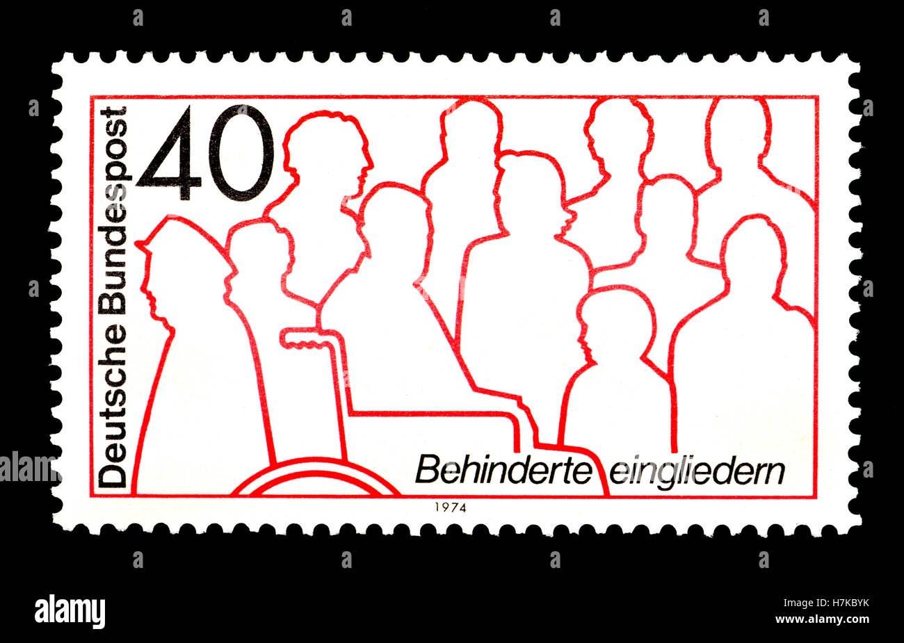 Deutsche Briefmarke (1974): Behinderung-Integration / Rehabilitation Stockbild