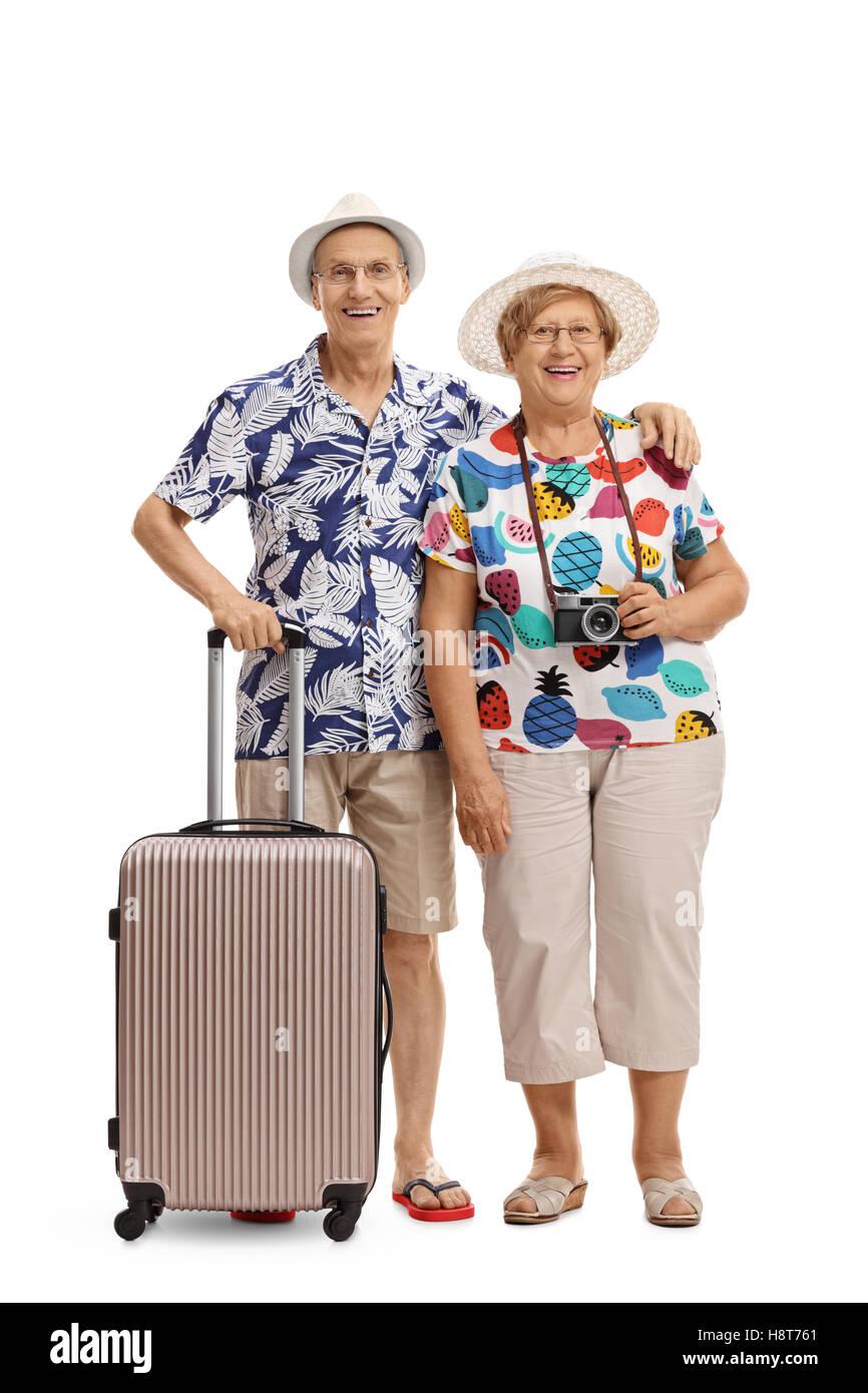 In voller Länge Portrait von ältere Touristen mit einem Koffer isoliert auf weißem Hintergrund Stockbild
