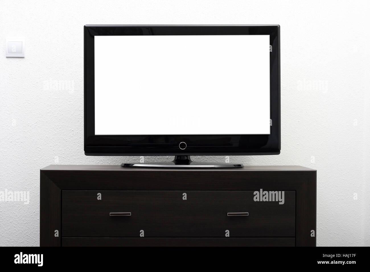 Tv Bildschirm Auf Braune Kommode Gegen Weisse Wand Stockfoto Bild