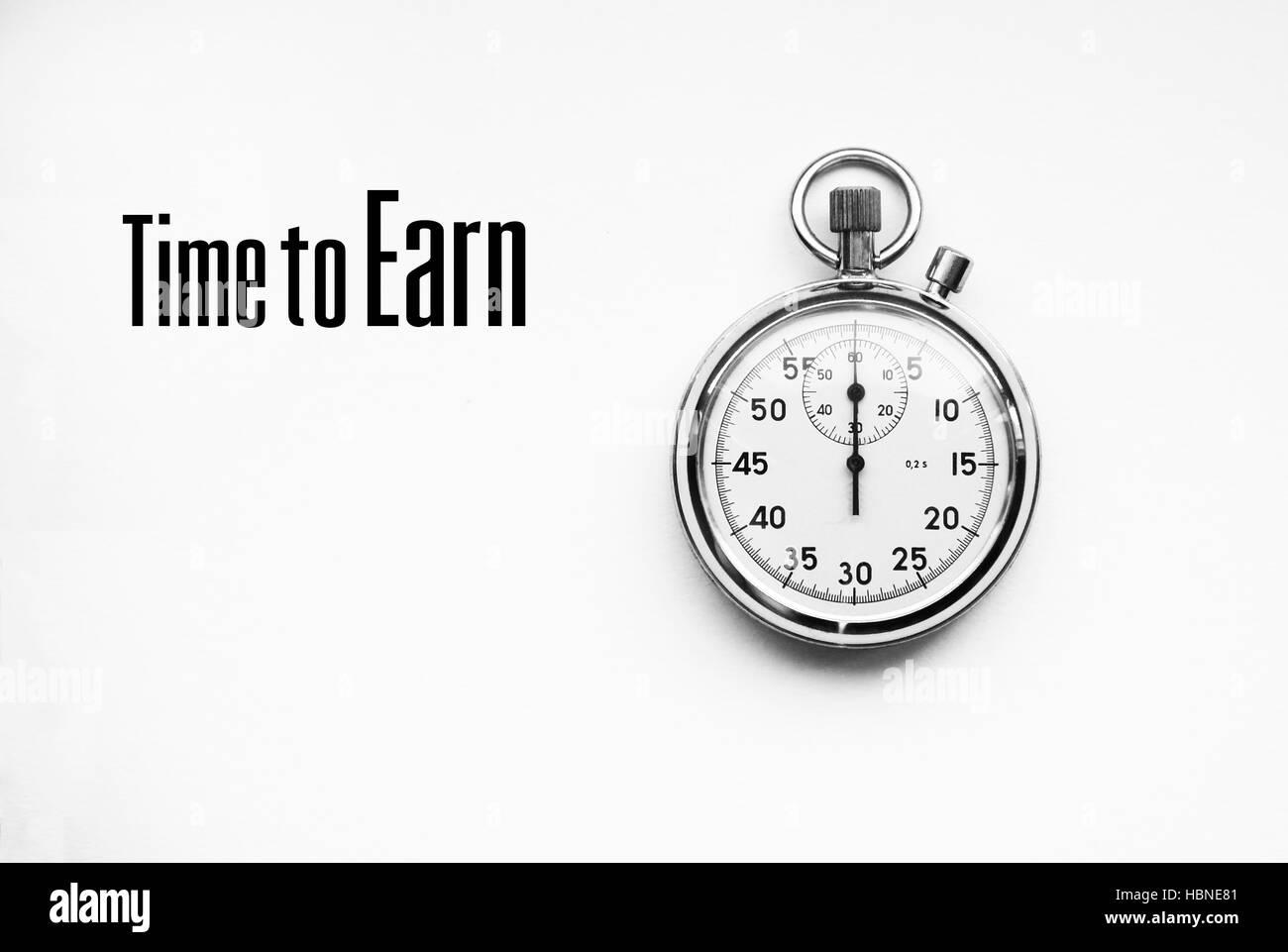 Foto der Stoppuhr mit Zitat: Zeit zu verdienen Stockbild