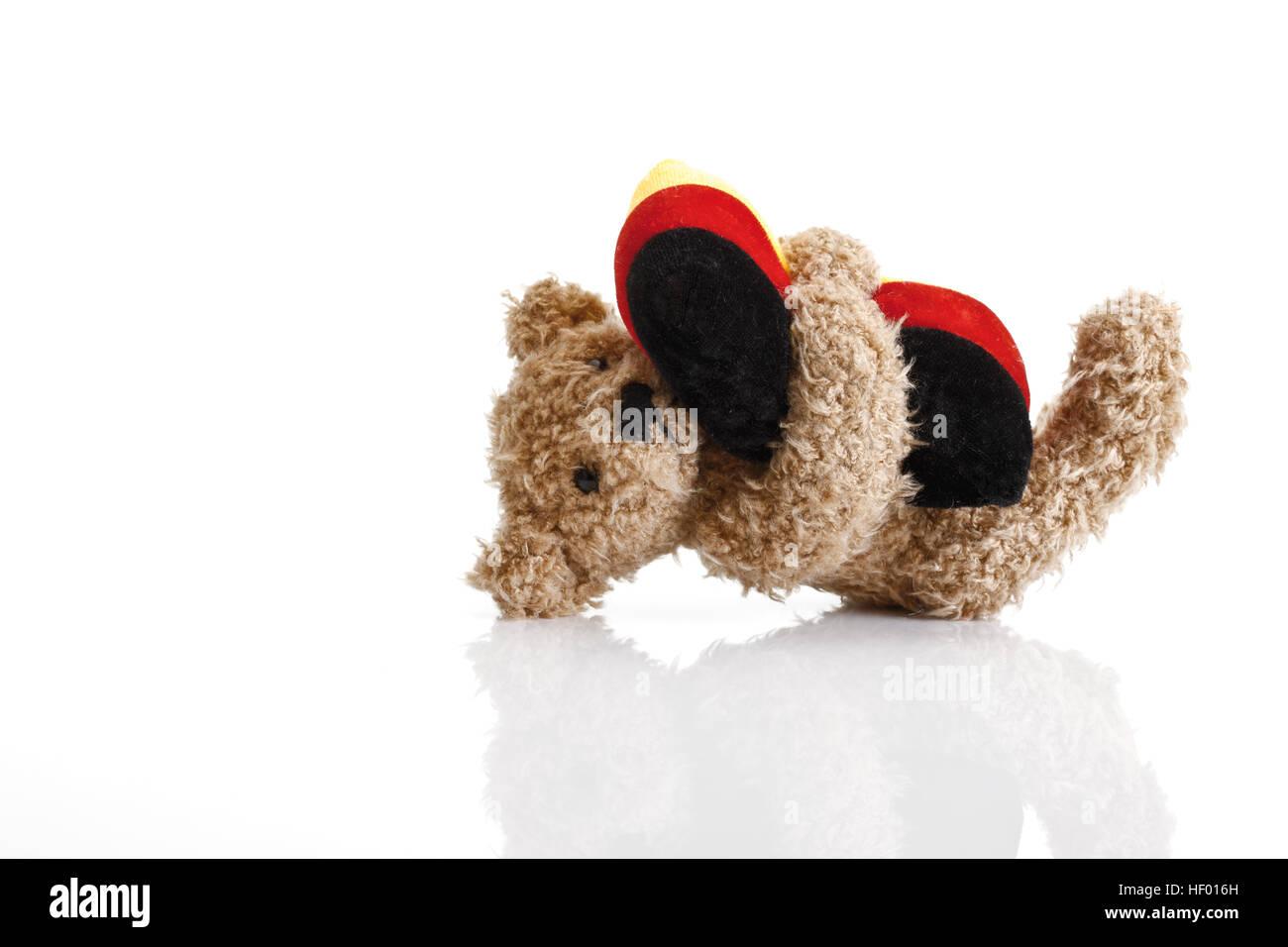 Kleinen Teddybär umarmt Kissen, deutschen Farben Stockfoto, Bild ...