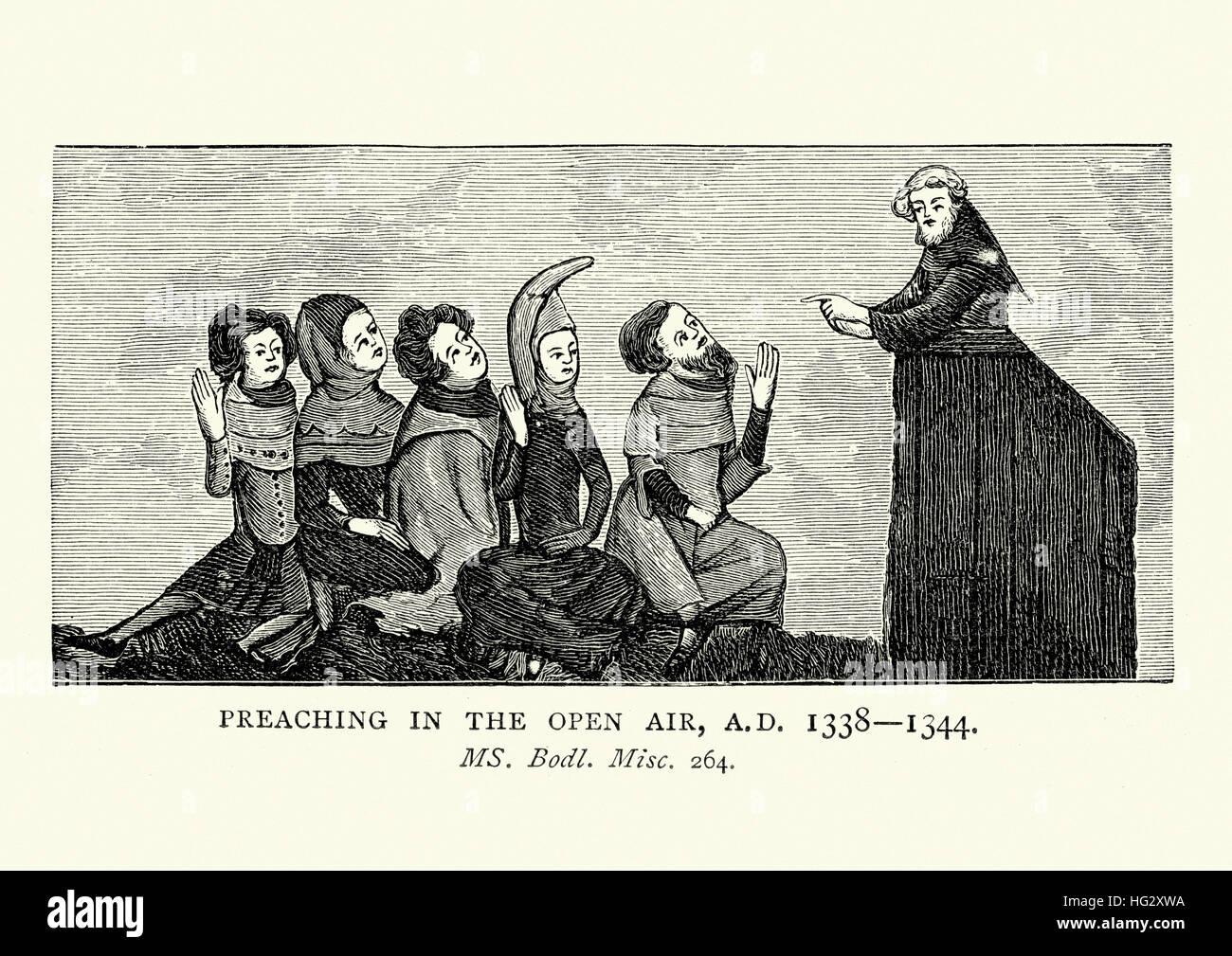 Mittelalterlicher Prediger predigen unter freiem Himmel, 14. Jahrhundert Stockbild