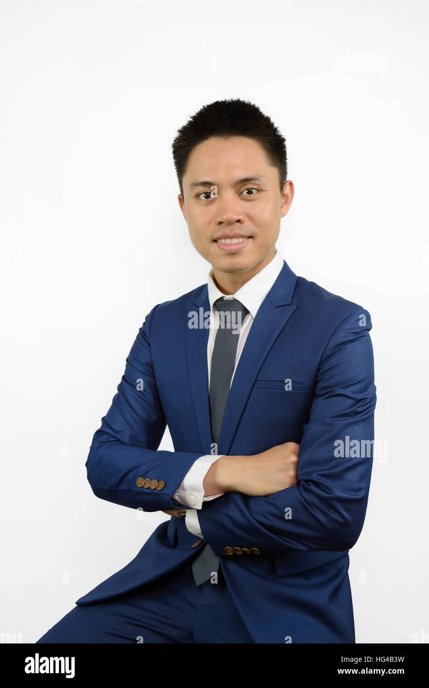 Asiatischen Mann Mit Blauen Anzug Und Krawatte Lachelnd Und Kreuz