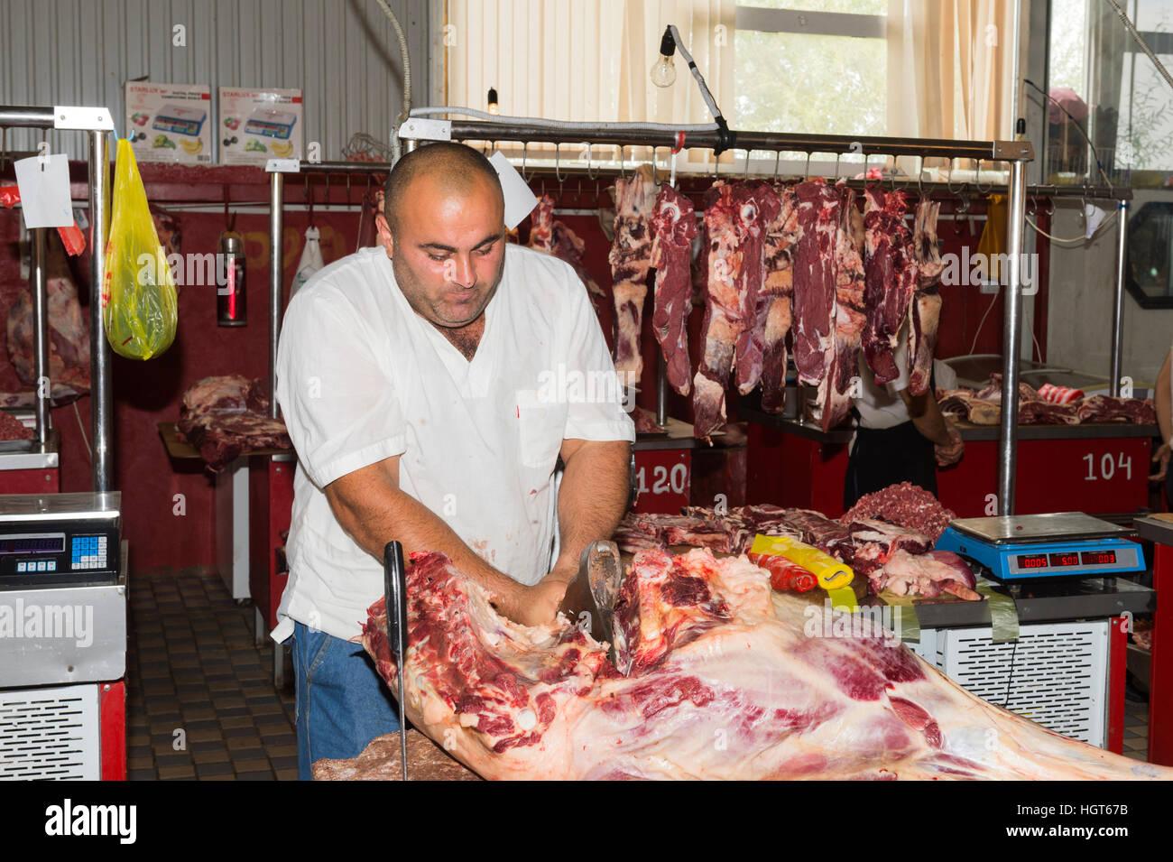 Metzger Schneiden von Fleisch, Samal Bazar, Schymkent, Region Süd, Kasachstan, Zentralasien, nur zu redaktionellen Stockbild