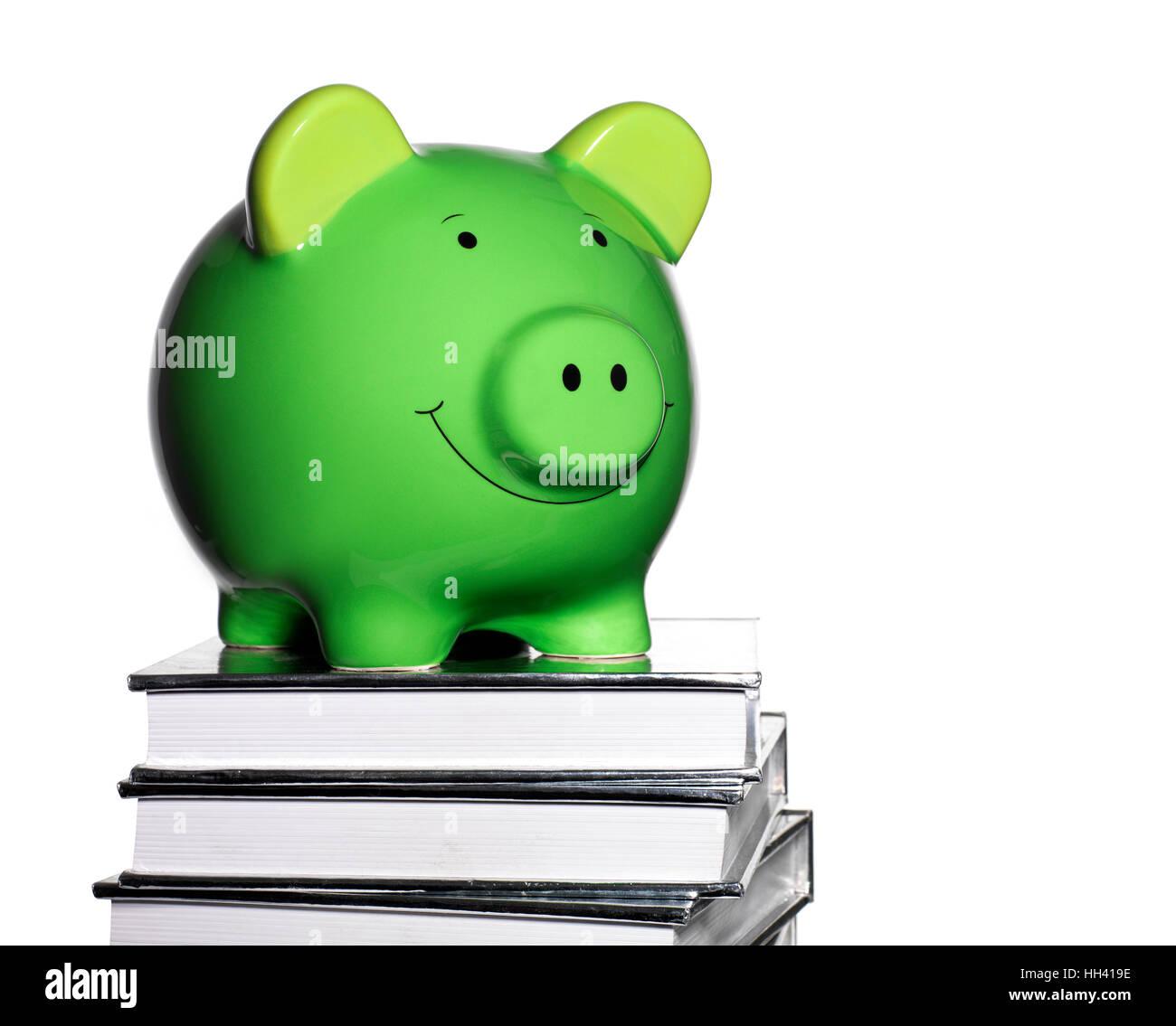 Green Piggy Bank an der Spitze einen Stapel Bücher Stockbild