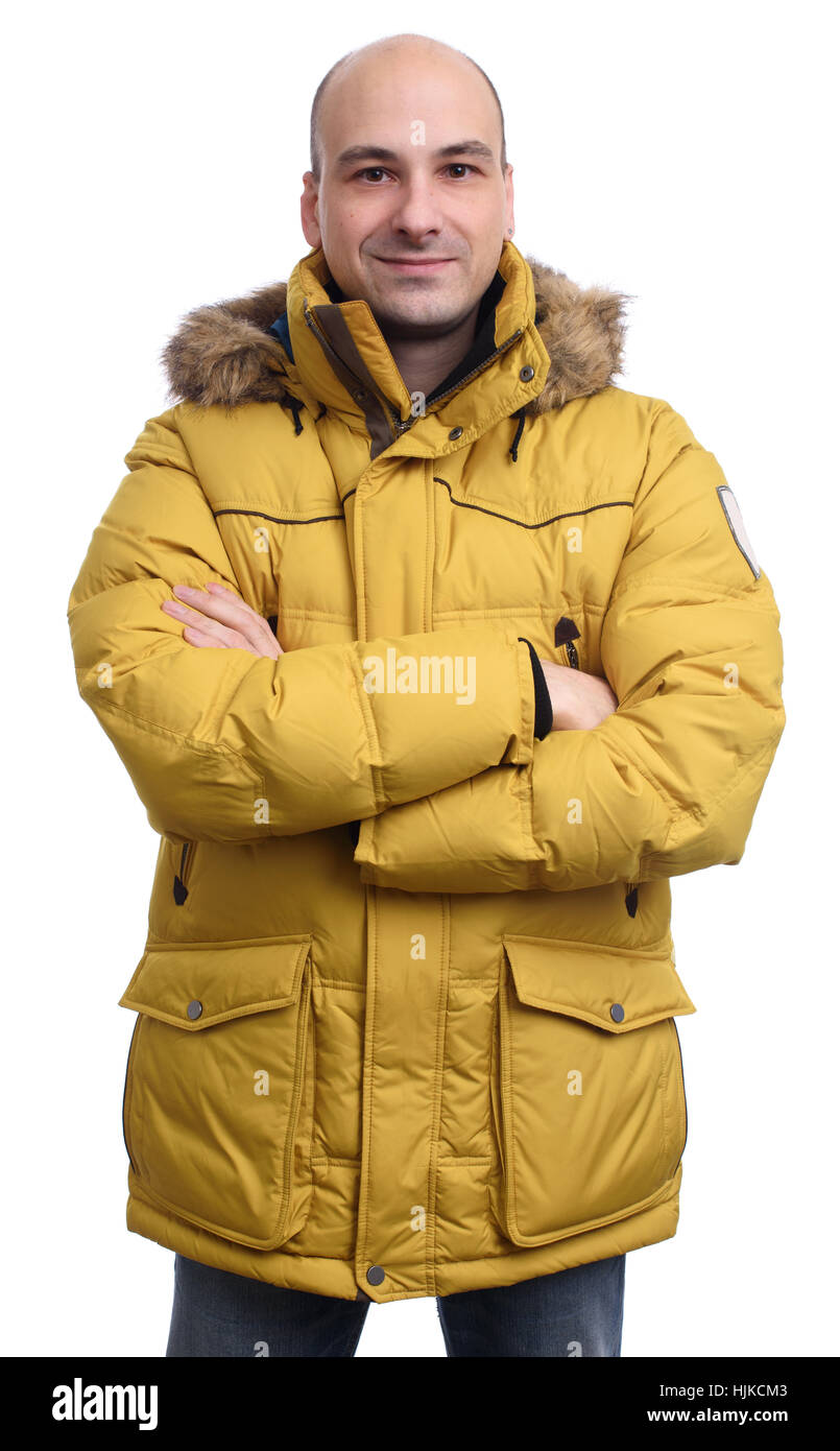 61db4411b340 Mann trug eine gelbe Winterjacke isoliert auf weißem Hintergrund Stockbild