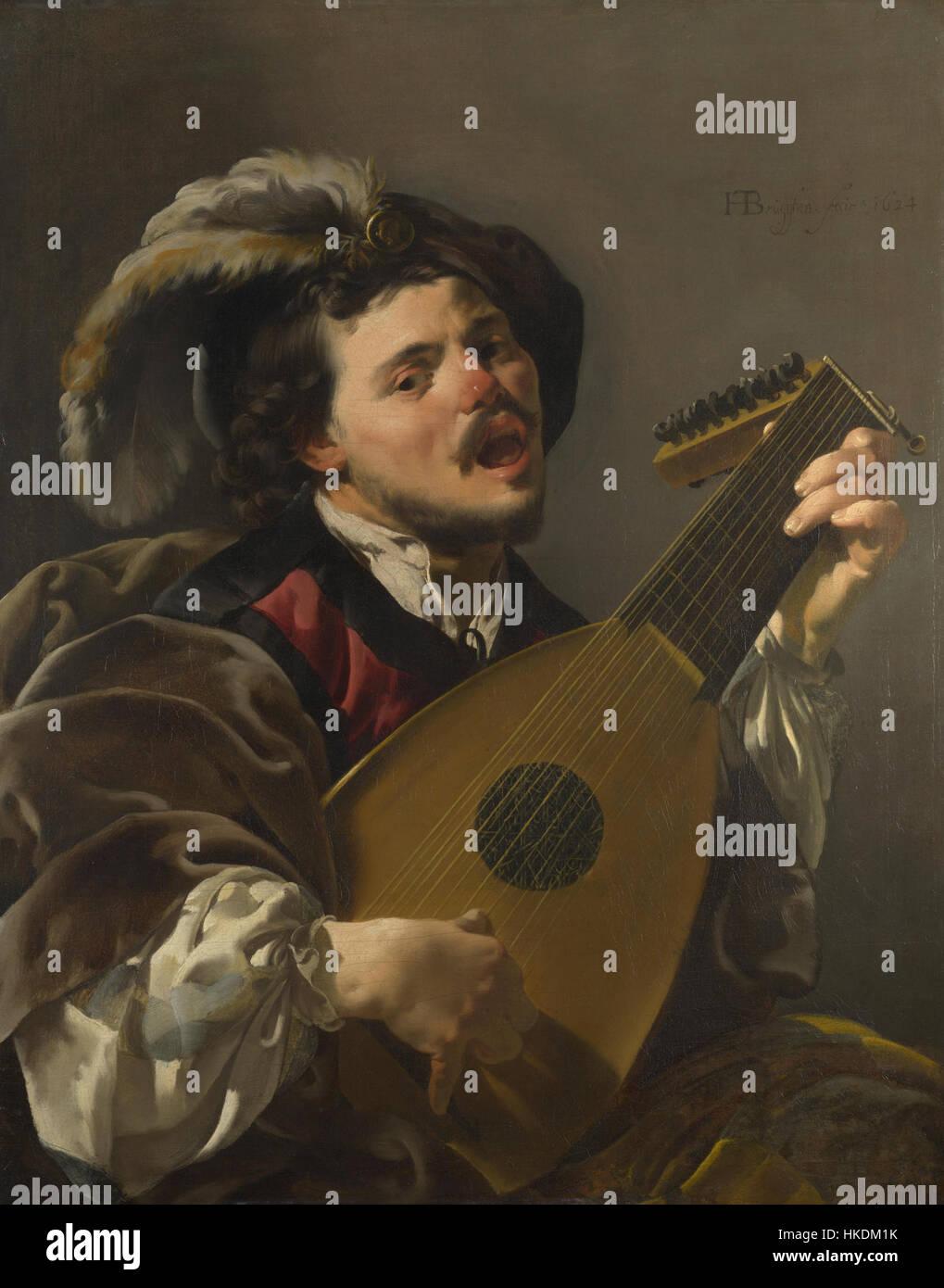 Ein Mann spielt eine laute Stockbild