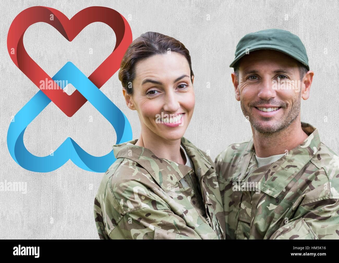 Porträt des Paares in Soldat Uniform umarmen einander Stockbild
