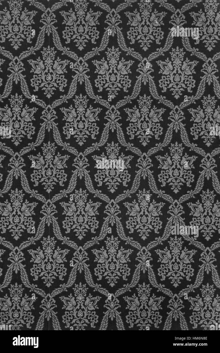 alte tapete mit barocken muster in antik anthrazit in schwarz und