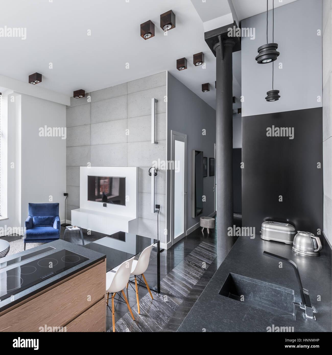 moderne-wohnlandschaft-mit-kuche-offen-zum-wohnzimmer-und-flur-hnnmhp.jpg