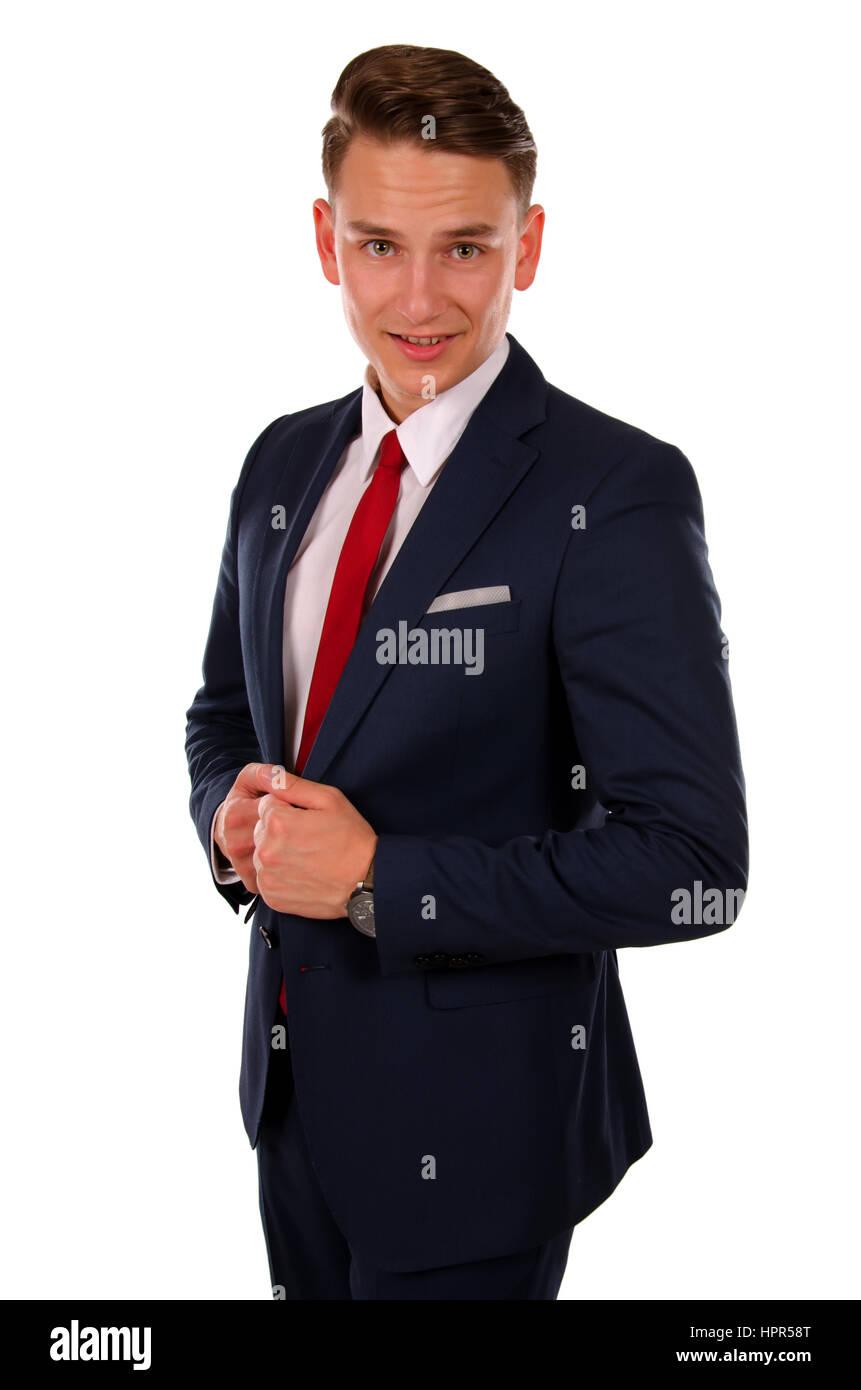 Bild eines jungen Geschäftsmann, der vor einer isolierten Hintergrund Stockbild