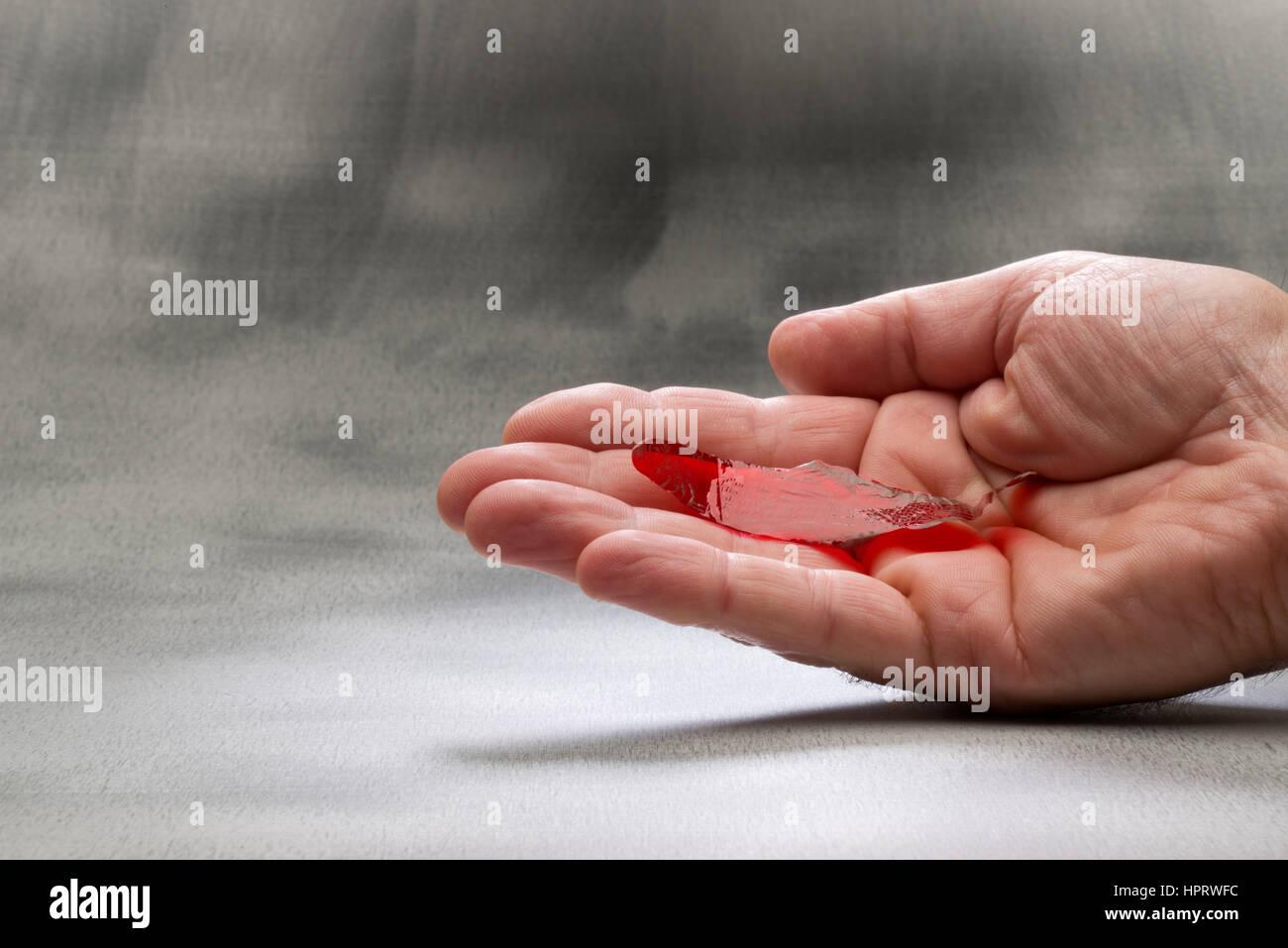 Fortune erzählt Fisch. Ort auf der Handfläche und es reagiert auf unterschiedliche Weise, je nach Ihrer Stockbild