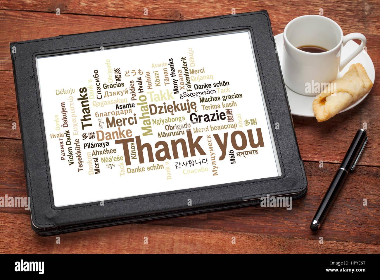 danke in verschiedenen sprachen wortwolke auf digitale tablett mit einer tasse kaffee gegen. Black Bedroom Furniture Sets. Home Design Ideas