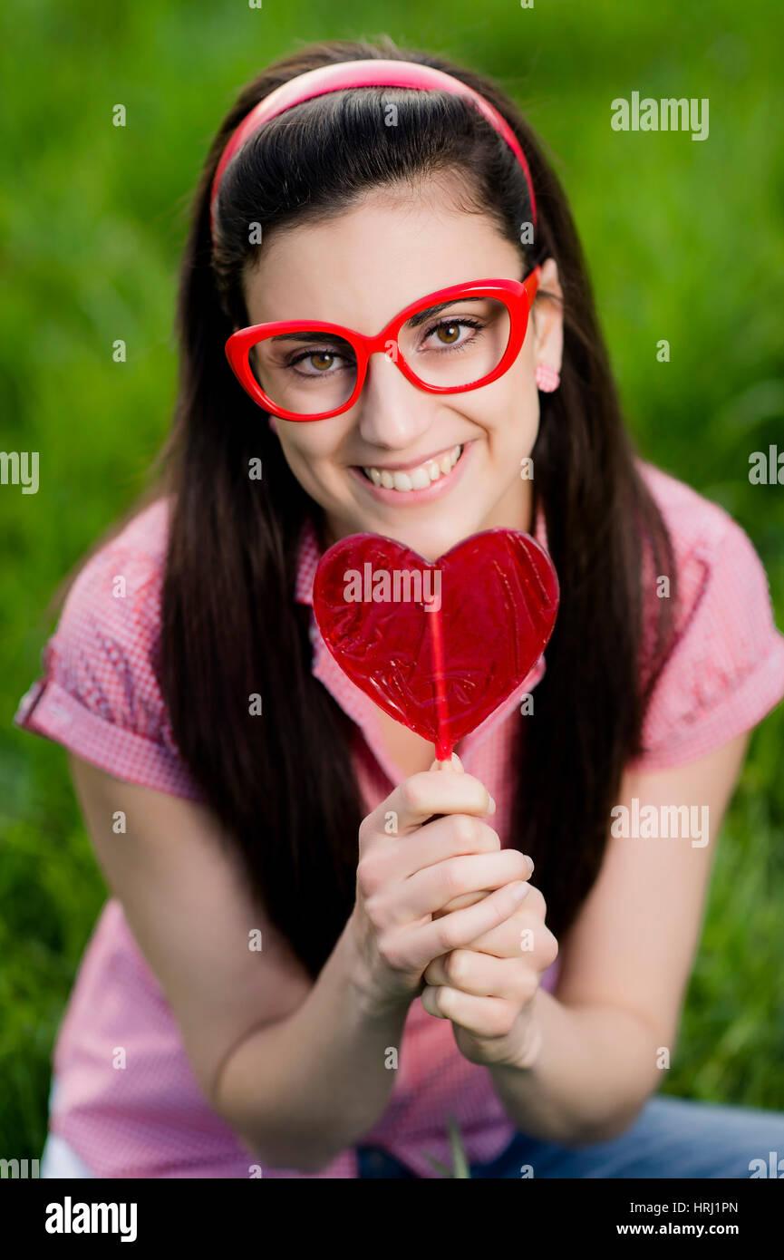 Frau Mit Herzlolly - Frau mit Herz Stockfoto