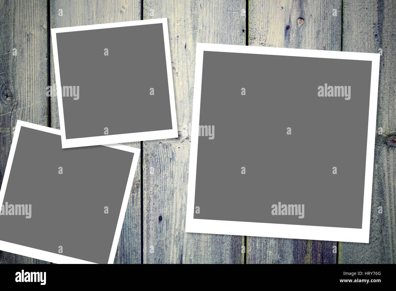 Drei instant Vintage weißen Bilderrahmen mit leeren grauen Bereich ...
