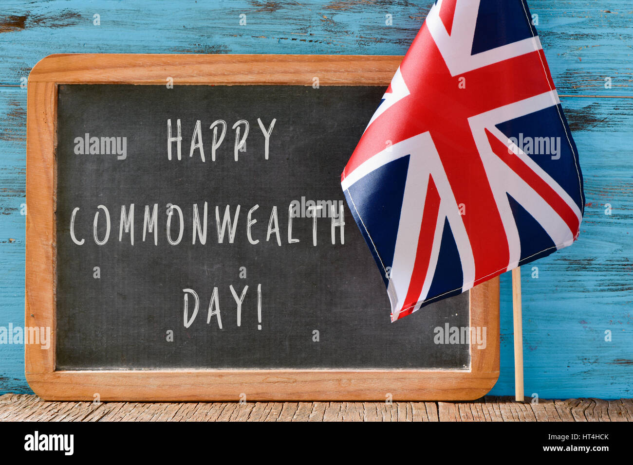 ein Holz-gestaltete Tafel mit dem Text zufrieden Commonwealth-Tag ...